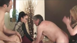 Fetish Liza and Mistress Sidonia Dominate Their Submissive Cuckold Husbands